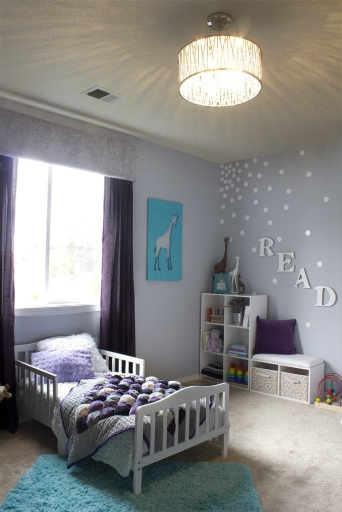 Little girl's bedroom in shades of purple image.