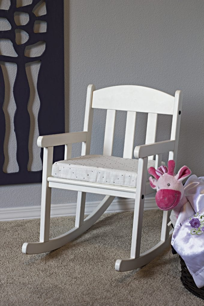 Child's white rocking chair image.