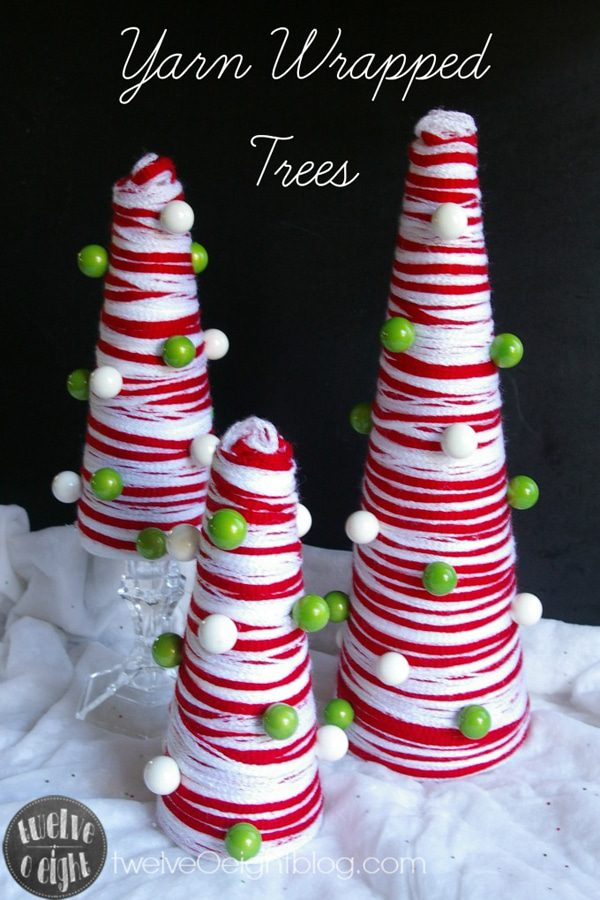Mini Christmas trees wrapped with red and white yarn image.