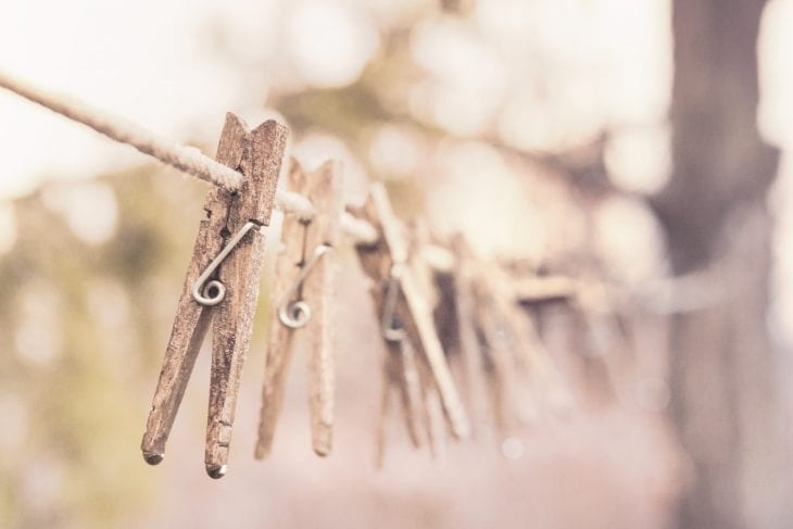 Clothespins on a rope image.