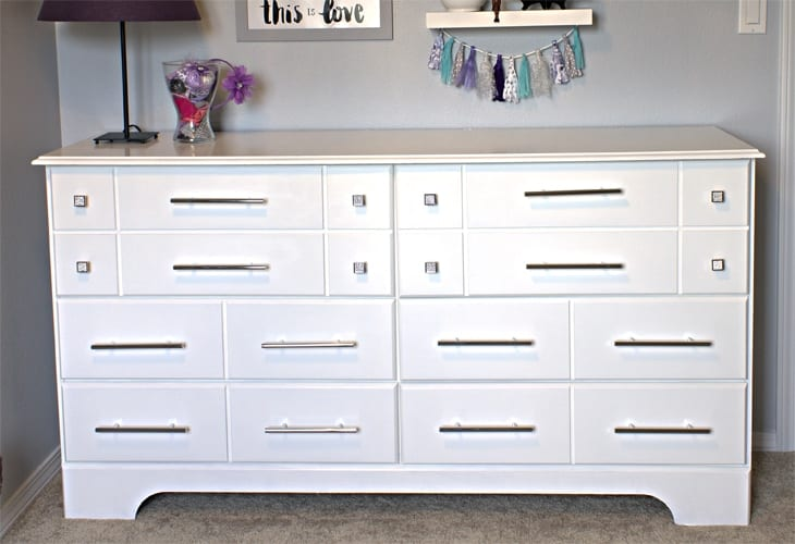 Check out this easy, DIY, glam dresser makeover!! The difference between the before and after is INCREDIBLE and the new hardware is stunning!!