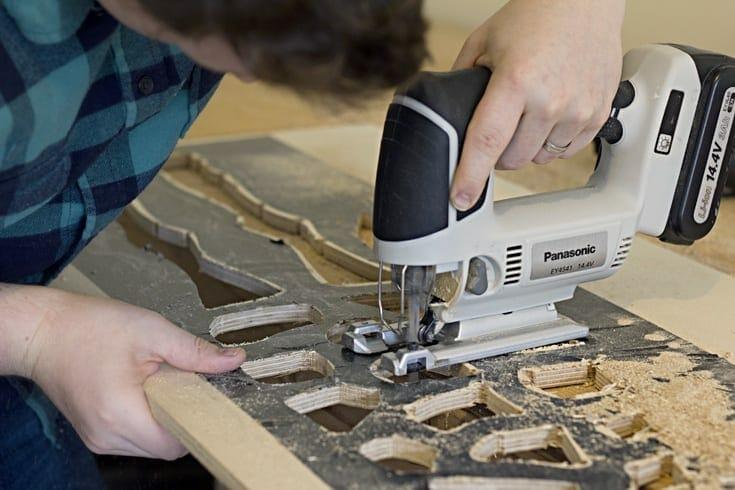 Man using a jigsaw image.