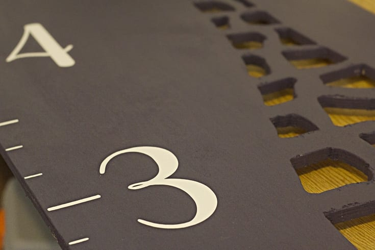 Numbers 3 and 4 painted white on a growth chart image.