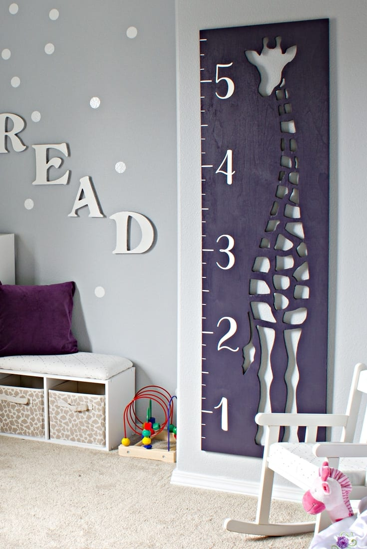 Purple giraffe growth chart with the word READ next to it image.