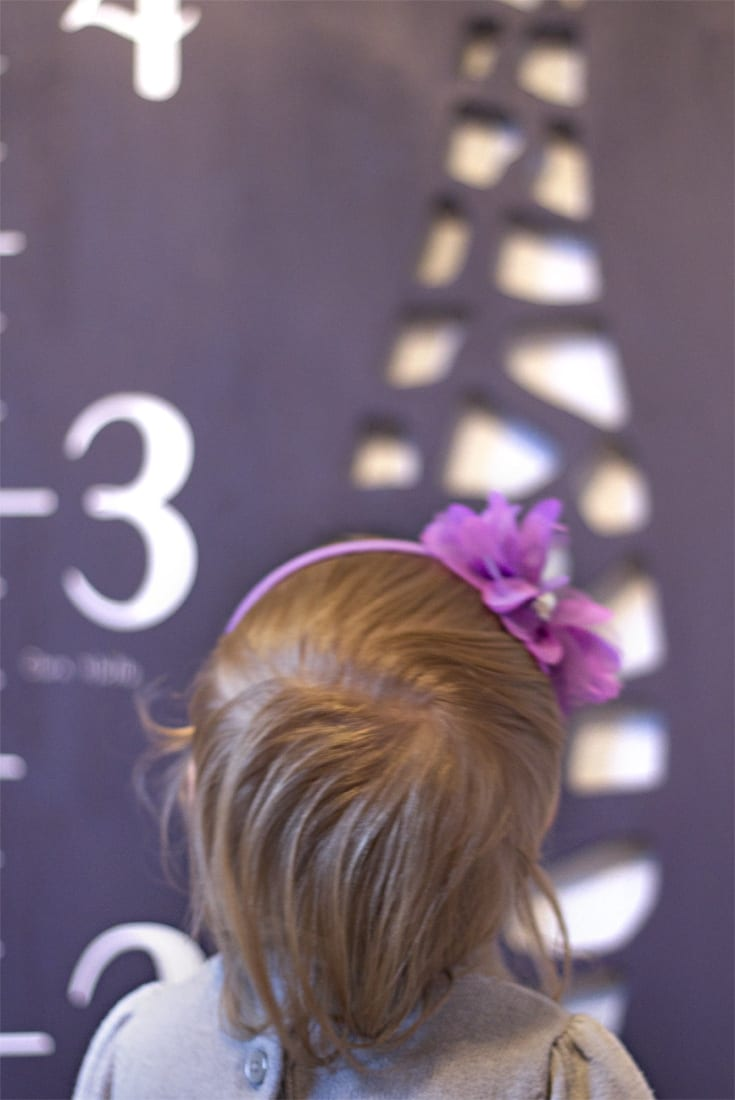 Little girl in purple headband image.