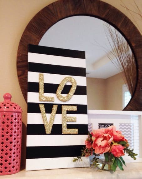 Black and white sign with letters spelling love image.