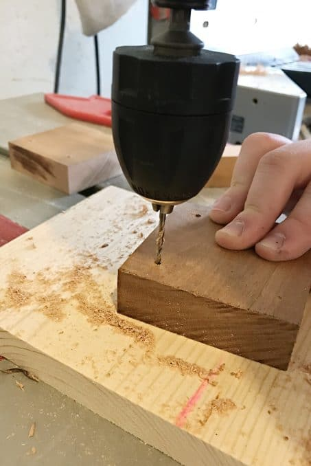 Drilling into a piece of wood image.