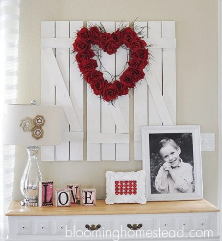 Heart-shaped wreath made of red roses image.