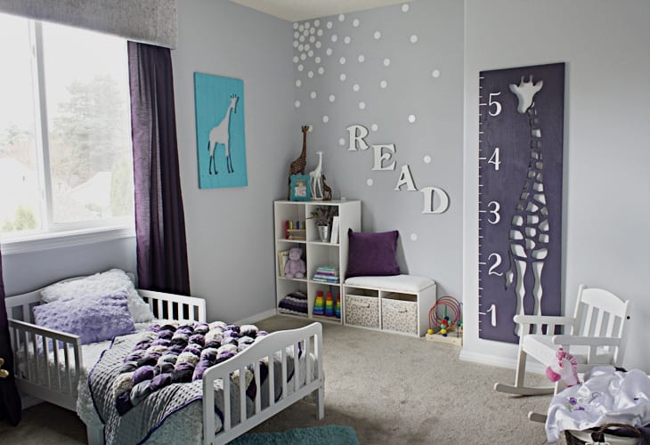 Little girl's bedroom with a feature wall and the word READ image.
