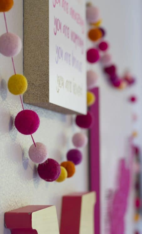 Colorful felt balls as a garland image.