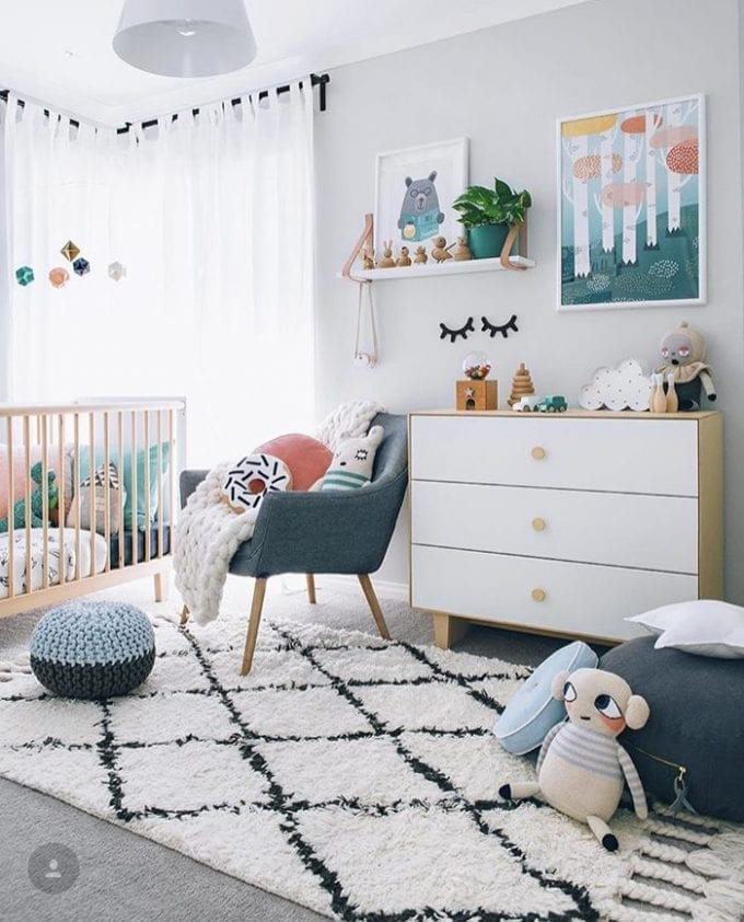 Neutral baby nursery room image.