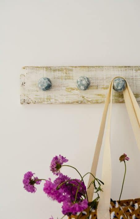 This easy DIY coat hook is perfect for a gorgeous hallway, bathroom, or to arrange necklaces in your bedroom. Check out this farmhouse inspired look!