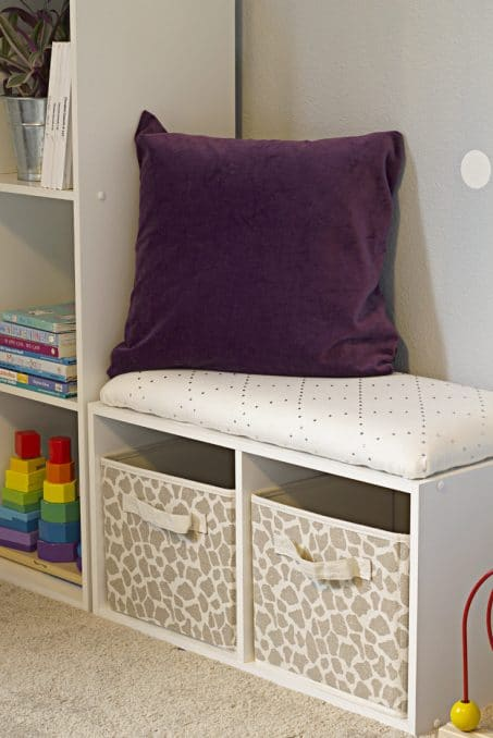 Child's organized space with purple pillow image.