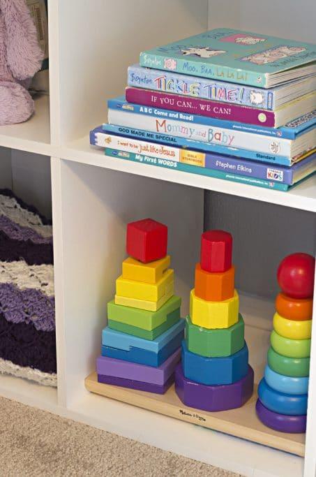 Books and toys on child's shelf image.