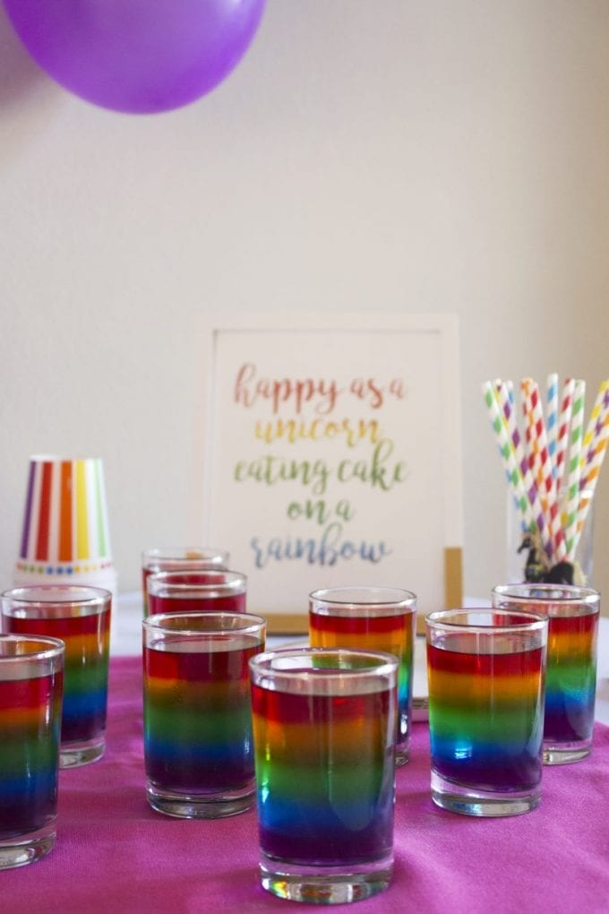 Rainbow themed birthday party jelly shots image.