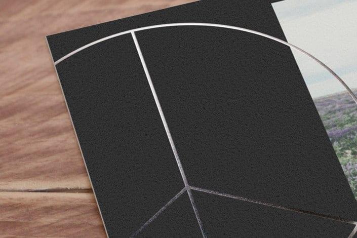 black card adn silver foil image.