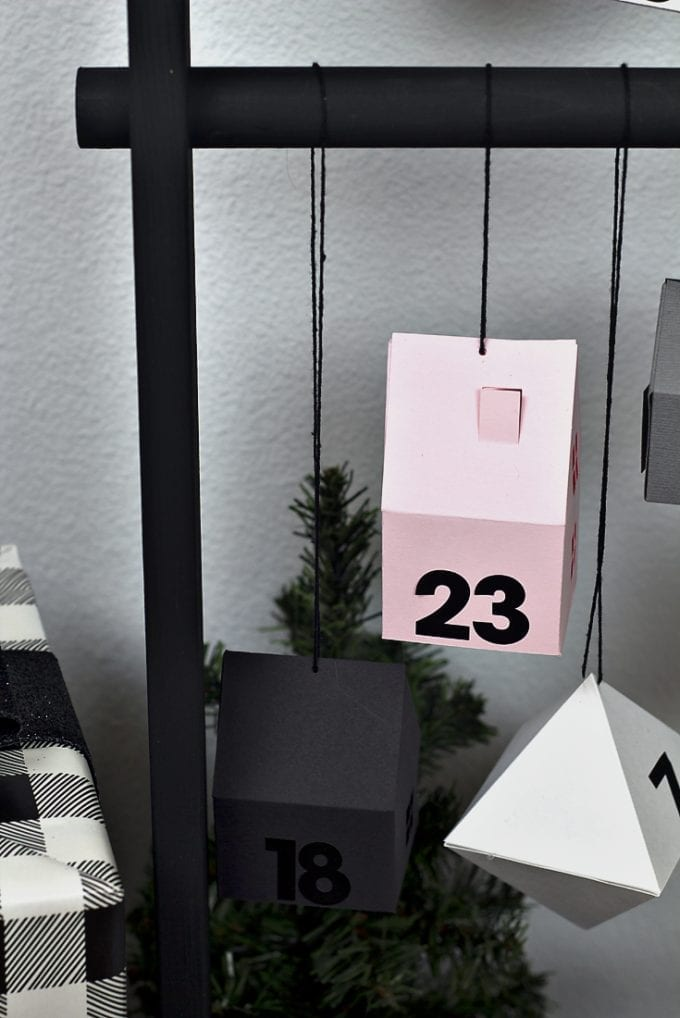 Modern advent calendar with houses and dates image.