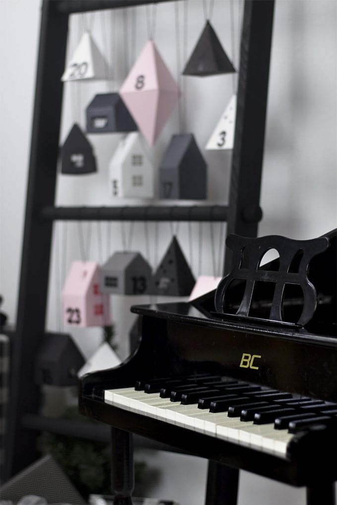 modern advent calendar beside a piano image