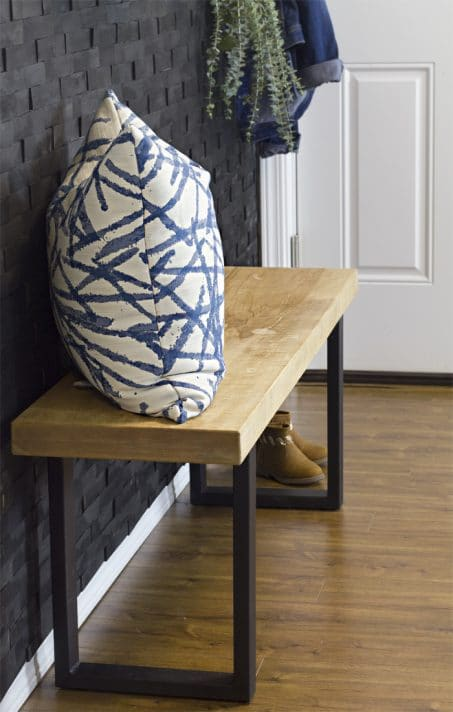 Build an industrial modern wood bench with this simple DIY tutorial. All you need is a wood slab and these industrial bench legs.