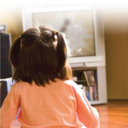 Small child watching TV image.