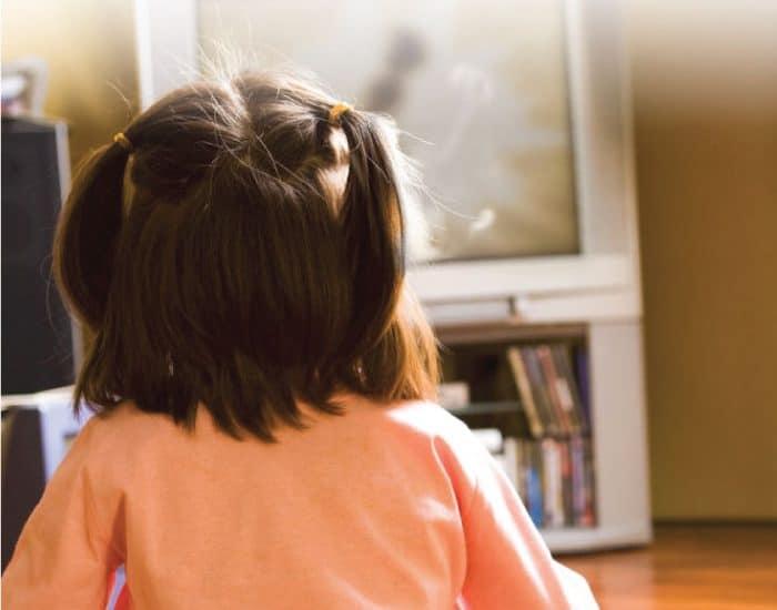 Small child watching TV image.