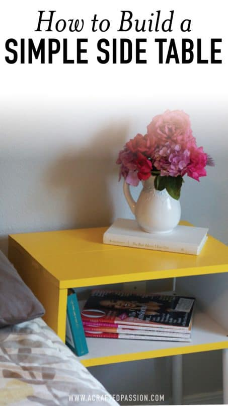 Yellow table with vase of flowers and a book image.