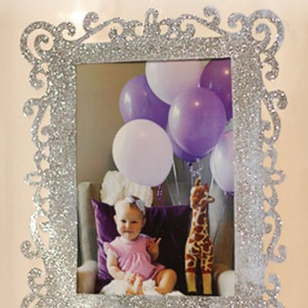 Picture frame featuring little girl with balloons image.