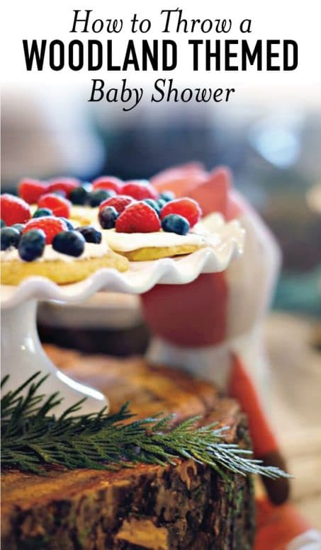 Tart with berries on a white cake stand image.
