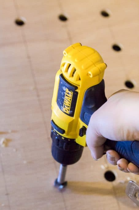 Fotsner bit on drill for pegboard holes image
