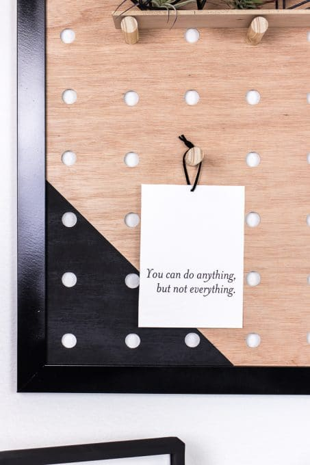 """You can do anything, but not everything"" quote hanging on diy giant pegboard image"