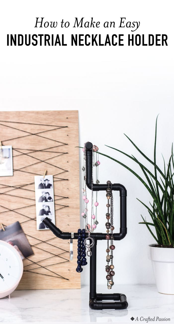 Make this DIY necklace holder to organize your jewelry. This modern industrial stand is the perfect display to have on your dresser. #jewelry #diy #industrial
