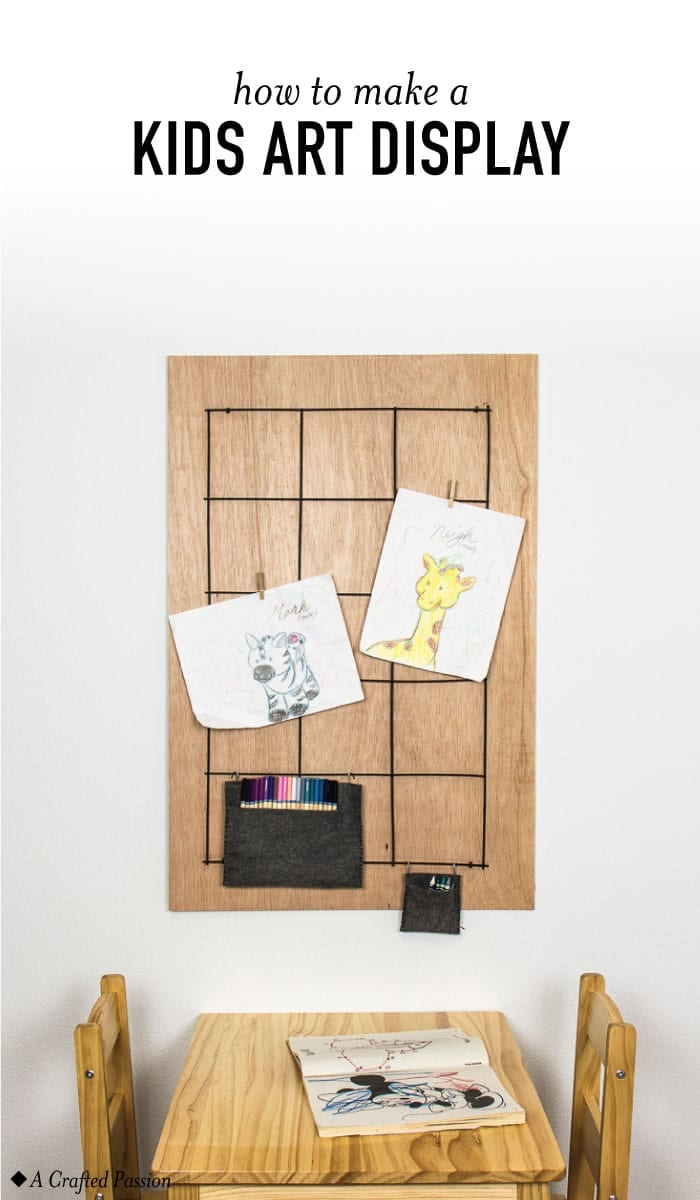 Create a kids art display with a board, rebar, and some clothespins. This DIY idea is perfect to hang on the wall for children to show off their latest creations.#diy #kidsart