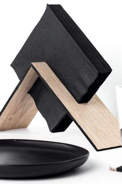 Make a modern wooden napkin holder with this simple DIY tutorial. This asymmetrical design is easy to make and looks great!