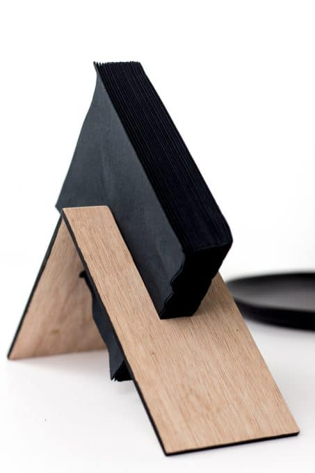 Make a modern wooden napkin holder with this simple DIY tutorial. This asymmetrical design is easy to make and looks great! #diy #build