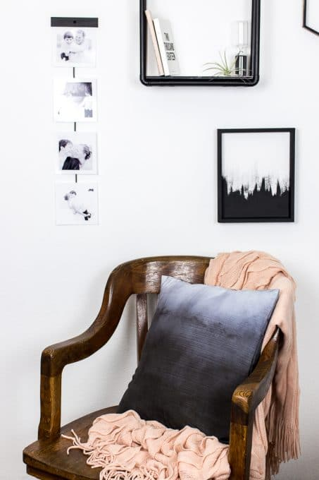 Image of mid-century chair with ombre throw pillow