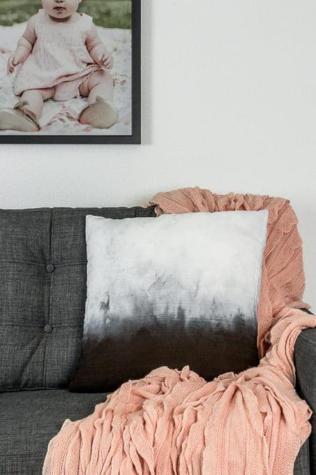 Image of ombre dye pillow on couch
