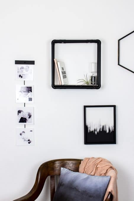 Create this simple pictures wall hanging using just a few items to show off some of your favorite photos. #diy #homedecor