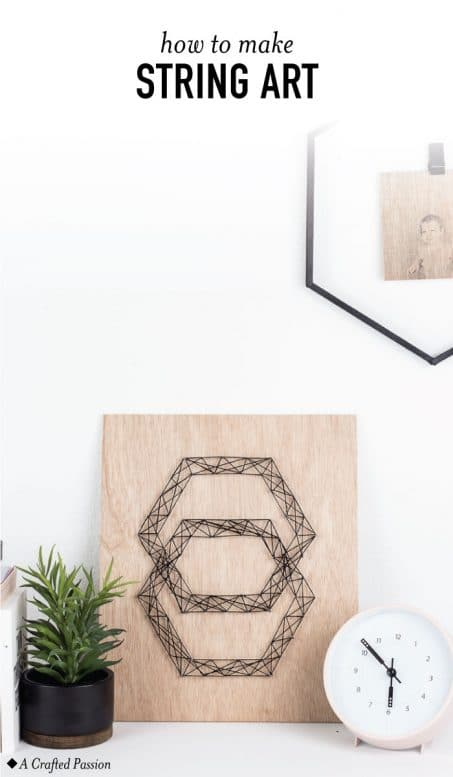 This geometric DIY string art is so easy to make with this simple tutorial and looks great on the wall. Plus, this modern hexagon design is too fun! #diy #homedecor