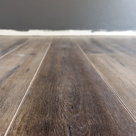 Don't let installing flooring intimidate you! Check out these 7 tips for installing laminate flooring and an update on week three progress on our One Room Challenge master bedroom makeover.