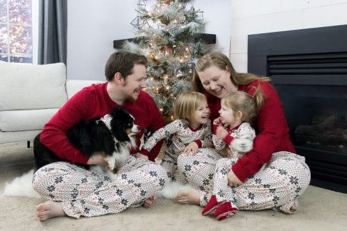 Image of happy family in Christmas jammies