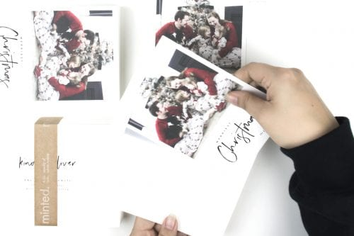 Image of stuffing Christmas card envelopes