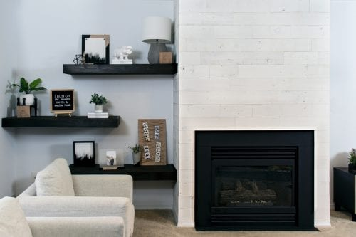 Looking for a quick and easy fireplace update? This modern makeover idea is perfect using peel and stick wood using Stikwood panels and some paint! #fireplacemakeover #stikwood #remodel