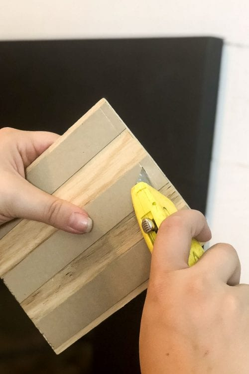 Image of cutting the back of Stikwood