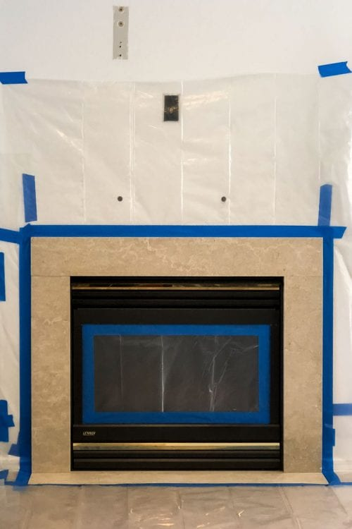 Image of marble fireplace with painter's tape