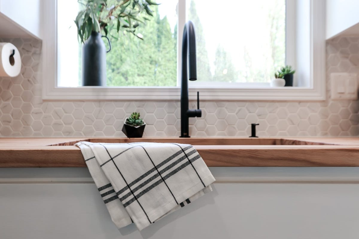 Image of striped towel on kitchen sink