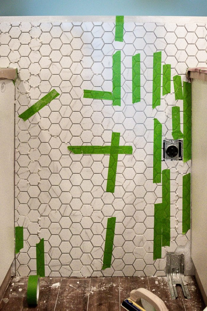 Image of FrogTape holding up the tiles