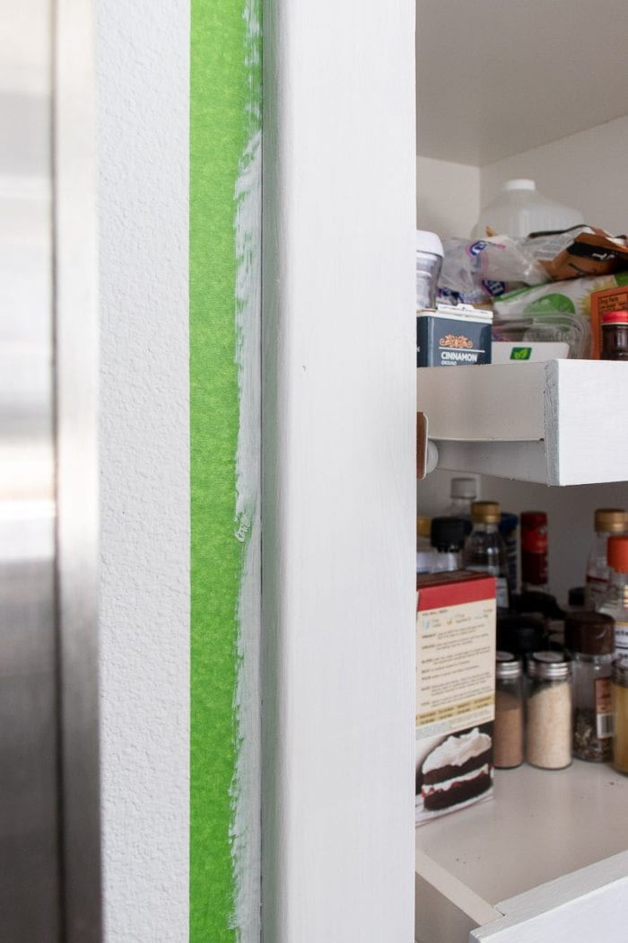 Image of in between cabinet with green FrogTape